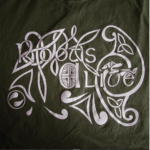 The Roots Alive logo in white on a dark green background. The logo says Roots Alive and is surrounded by celtic knot-style artwork.